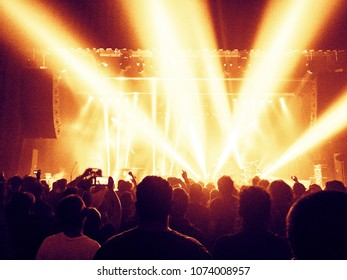 Live show musical performance with crowd silhouette