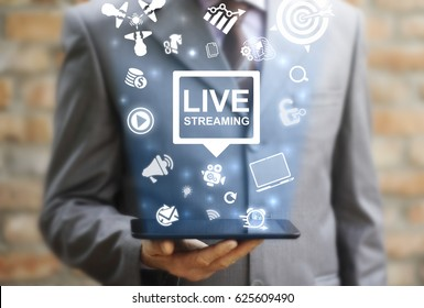 Live streaming social media web network concept. Man offers tablet computer with icon bubble live streaming on virtual screen. Broadcast online technology stream video and music. Internet marketing.