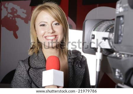 live TV transmission with a smiling  reporter in front of the video camera