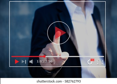 Live video,streaming concept.Business man press a play buttons