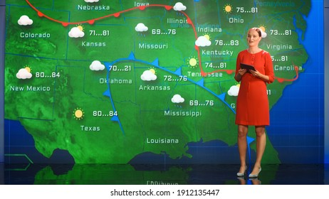 Live Weather News Studio with Professional Female On-Camera Meteorologist Standing Beside Screen and Making Gestures to Point at Weather Synoptic Map Chart for United States of America - Shutterstock ID 1912135447