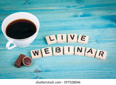 live webinar. Coffee mug and wooden letters on wooden background