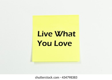 live what you love word written on yellow sticky notes. isolated on white