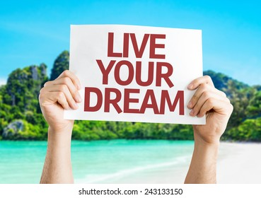 Live Your Dream card with a beach on background