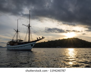 liveaboard boat with sunset