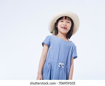 Lively and lovely Asian little girl, happy to play and dancing. on white background