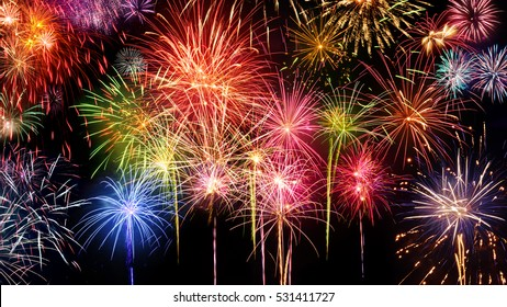 Lively multi-colored fireworks on black background, ideal for New Year, party or any celebration event