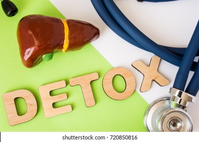 Liver detox concept photo. Word detox of volumetric letters is near 3D liver model and  medical stethoscope. Medical diet program for detoxification and cleanse of biliary system for women and men