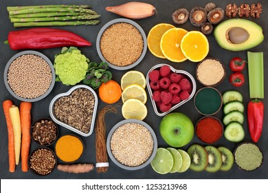 Liver detox diet health food concept with fruit, vegetables, herbal medicine, seeds, nuts, grains, cereals, and supplement powders. High in antioxidants, omega 3, vitamins &  dietary fibre. Top view.