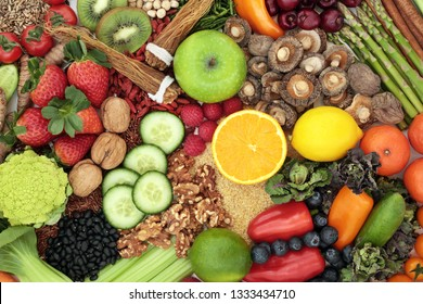 Liver detox health food concept with fresh fruit, vegetables, herbs, spices, nuts, grains and seeds. Foods high in antioxidants, anthocaynins, vitamins, minerals and dietary fibre. Top view.