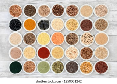 Liver detox health food selection in porcelain bowls on rustic wood background. Foods high in antioxidants, anthocaynins, vitamins, dietary fibre and smart carbohydrates.