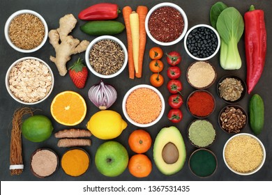 Liver detox super food concept with fruit, vegetables, herbs, spices, grains, seeds, cereals, herbal medicine and supplement powders. Health foods high in antioxidants, vitamins &  dietary fibre.