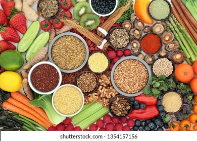 Liver detox super food with fruit, vegetables, herbs, spices, legumes, grains, seeds, herbal medicine and supplement powders. Health foods high in antioxidants, vitamins &  dietary fibre. Top view.