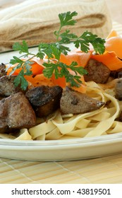 liver goulash on pasta with organic carrot