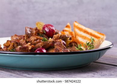 Liver with red and white grape garnished with thyme