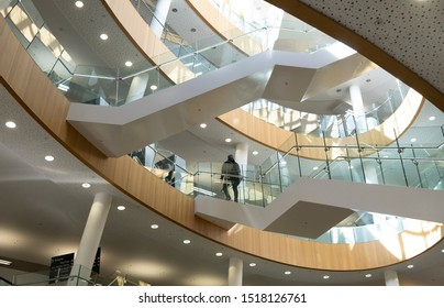 Liverpool Central Library, Liverpool, UK; March 25th 2019 - overlapping staircases of glass and steel, stunning modern architecture behind a classical facade