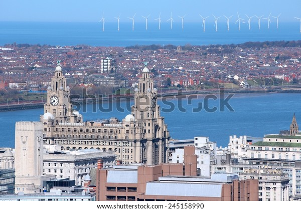 Liverpool - city in Merseyside county of North West England (UK). Aerial view with famous Royal Liver Building and offshore wind farm.