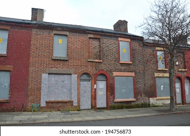 LIVERPOOL - December 10: derelict terraced houses in Toxteth, Liverpool, UK on December 10, 2013. The house with graffiti was the birthplace of Ringo Starr, drummer of The Beatles.