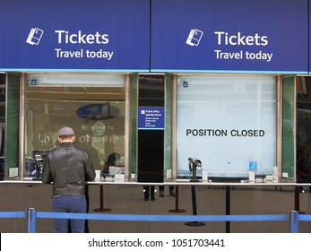 LIVERPOOL, ENGLAND - APRIL 16, 2015: Customer at the ticket office inside the Lime street station in Liverpool, England