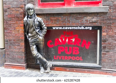 LIVERPOOL, ENGLAND - APRIL 3, 2017: John Lennon statue in front of the Cavern Pub. The sculpture was unveiled on 16 January 1997 outside the pub, located in front of the Cavern Club.