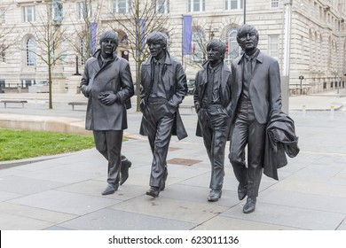 LIVERPOOL, ENGLAND - APRIL 4, 2017: Bronze statues of the Beatles in Liverpool Waterfront. The monument has been donated to the city by the Cavern Club.