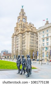 LIVERPOOL, ENGLAND, APRIL 7, 2017: Statue of the Beatles in front of the royal liver building in Liverpool, England