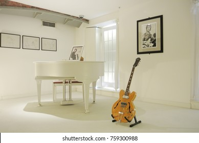 LIVERPOOL, ENGLAND - AUGUST 10, 2013: Interior of The Beatles Story Museum at Liverpool, a famous white room of John Lennon where plays his song Imagine.