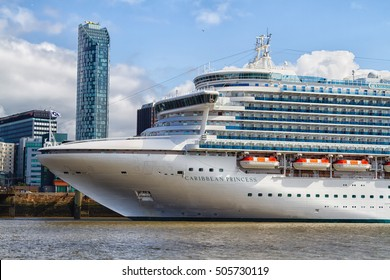 LIVERPOOL, ENGLAND - AUGUST 17, 2016: Cruise liner berthed in Liverpool, England, UK with the famous skyline including the Liverbirds in the background, United Kingdom
