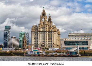 LIVERPOOL, ENGLAND - AUGUST 27, 2016: Liverpool, England. Skyline from the River Mersey at Pier Head showing the Royal Liver building with the famous Liver birds.United Kingdom