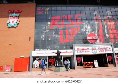LIVERPOOL, ENGLAND - JULY 15, 2013:  Bill Shankly statue in Liverpool Football Club, Museum and tour centre, Liverpool FC club store in Liverpool, England, UK