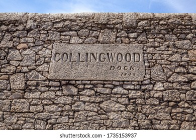 Liverpool, England - June 20, 2010: Sign on the old stone wall of the Collingwood Dock, part of the Port of Liverpool, England