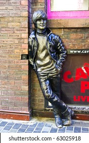 LIVERPOOL, ENGLAND - JUNE 5: Statue of John Lennon at Mathew Street on June 5 2009 in liverpool, England. John Lennon was one of Musician legend - The Beatles