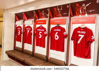 LIVERPOOL - ENGLAND, MAY 18, 2019 : Player's jerseys hung in front of lockers in the changing room at Anfield stadium the home ground of Liverpool Football Club