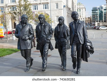 LIVERPOOL, ENGLAND OCTOBER 27 2017 A bronze sculpture of the four Liverpool Beatles on Liverpool Waterfront by Andrew Edwards.