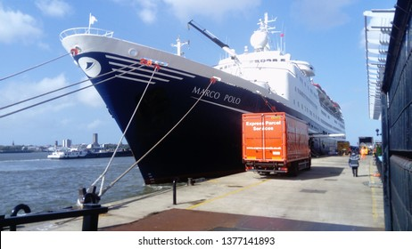 Liverpool  England September 29 2017. Sunny Quayside scene at Liverpool cruise terminal showing CMV lines Marco Polo ship awaiting loading with delivery vehicle parked in foreground.