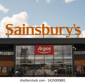 Liverpool England UK june 06 2019 Sainsbury's superstore in liverpool cloudy sky background
