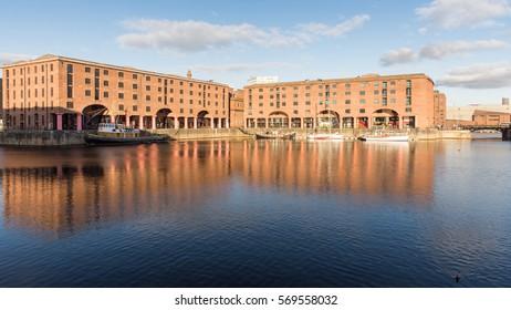 Liverpool, England, UK - November 11, 2016: Sun shines on the redeveloped Albert Dock in Liverpool's historic docks.