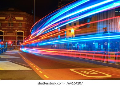 Liverpool Hood street bus terminal at night and traffic trails of public transport speed limit sign on the road doubledecker bus passing county Merseyside United Kingdom of Great Britain 2017