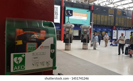 Liverpool, Merseyside. UK. 07/13/2019 A Cardiac Science heart  defibrillator hanging on the wall of of the main concourse of Lime Street train station.