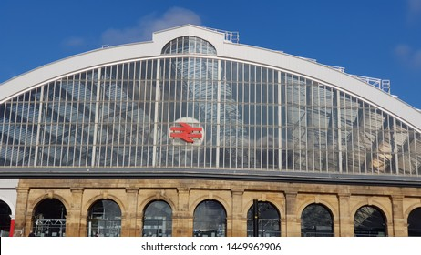 Liverpool, Merseyside. UK. 07/13/2019 Lime Street Train Station exterior against a blue sky close up frame of the steel roof sat on top of the brickwork showing the classic British Rail logo.