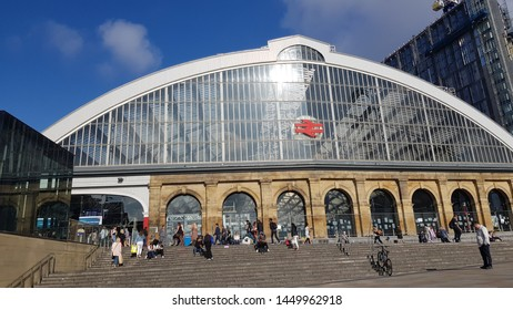 Liverpool, Merseyside. UK. 07/13/2019 Lime Street Train Station exterior against a blue sky close up showing commuters on the steps outside the station.