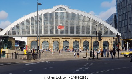 Liverpool, Merseyside. UK. 07/13/2019 Lime Street Train Station exterior against a blue sky shot from across the road showing commuters and passers by.