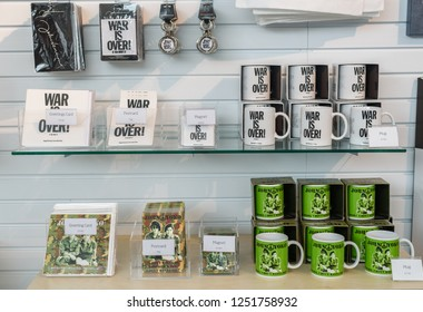 "Liverpool, Merseyside, Uk August 16 2018 :Various John Lennon and Yoko Ono souvenirs being sold at the ""Double Fantasy"" exhibition in Liverpool museum August 2018."