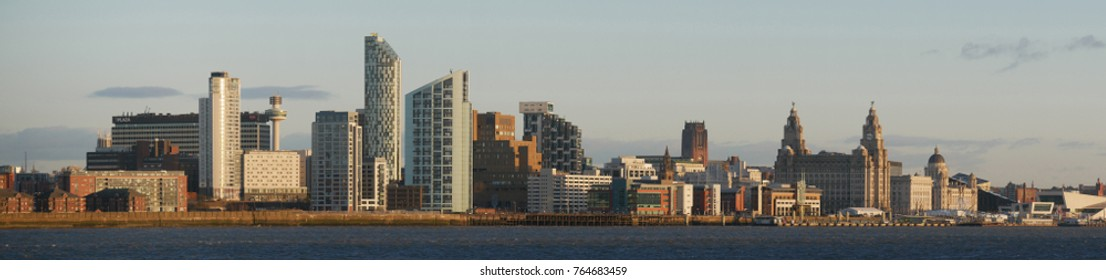 Liverpool, Merseyside, UK - November 12, 2017: Liverpool's UNESCO listed waterfront including modern office buildings, Liverpool's Anglican Cathedral, the Three Graces and the new Museum of Liverpool.