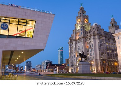 LIVERPOOL, MERSEYSIDE/ENGLAND - DECEMBER 10, 2012: Pier head ferry terminal with Liver Buildings and statue of Edward VII, Liverpool, England