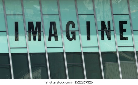 Liverpool, Merseyside/UK - July 23rd 2019: the John Lennon imagine sign at the Museum of Liverpool on tinted blue glass