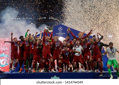 Liverpool players celebrate with the trophy on the stage during the awards ceremony after the UEFA Champions League Final at Estadio Wanda Metropolitano on June 1, 2019 in Madrid, Spain.