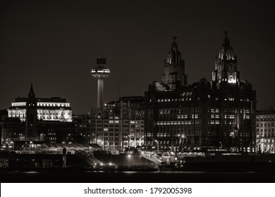 Liverpool Royal Liver Building at night with buildings in England in United Kingdom