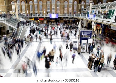 Liverpool street station in rush hour with all faces obscured and logos/trademarks removed