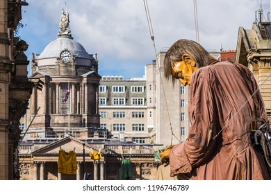 Liverpool Town Hall behind the sleeping giant man.Captured on day two (Saturday 6th October 2018) in Liverpool during Liverpool's Dream - the final saga of the Giants by Royal De Luxe.